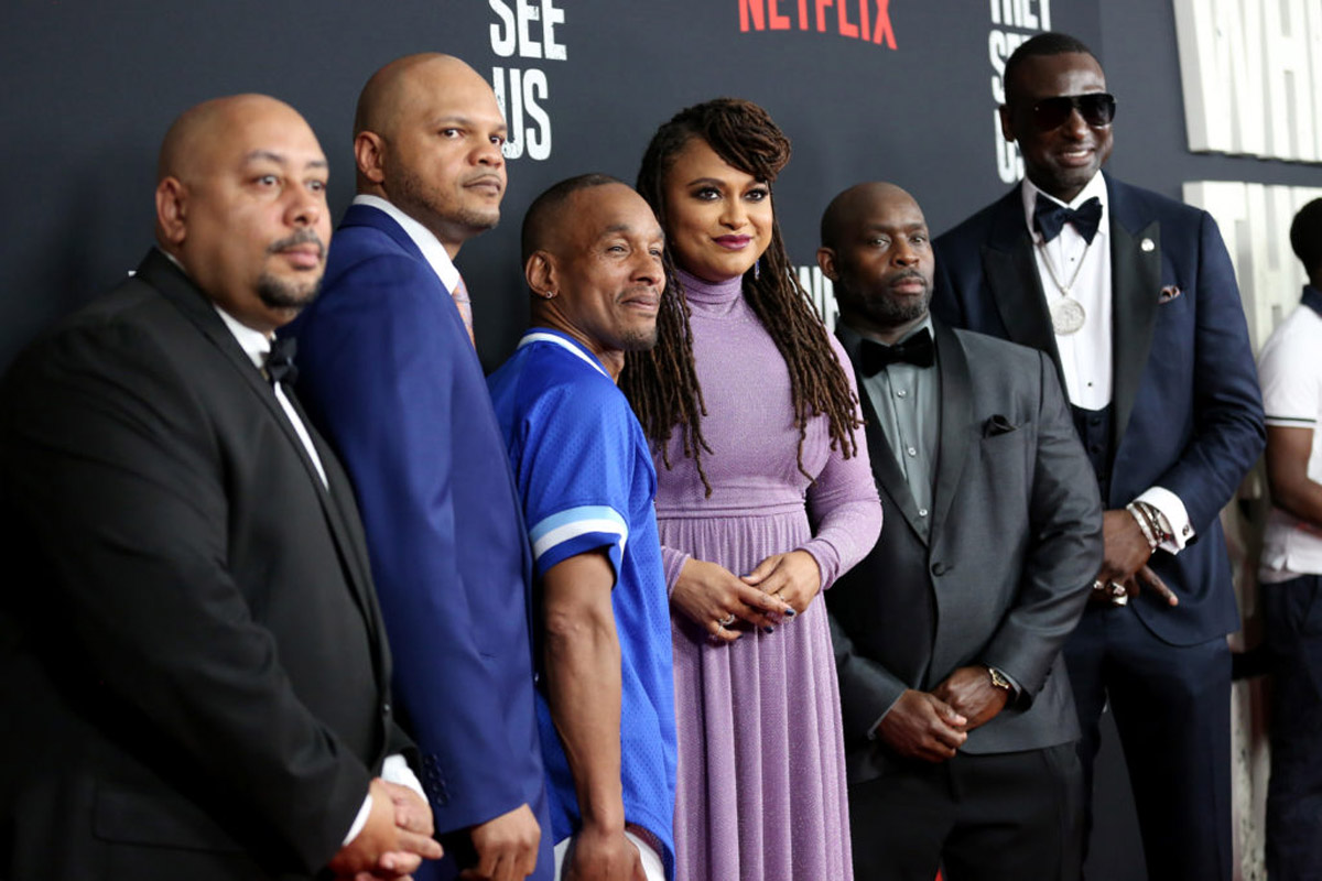 Ava DuVernay poses for photos with Raymond Santana, Kevin Richardson, Korey Wise, Antron McCray and Yusef Salaam at Netflix screening event of When They See Us