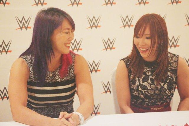 Asuka and Kairi Sane sharing a laugh at the WWE Live media interview.