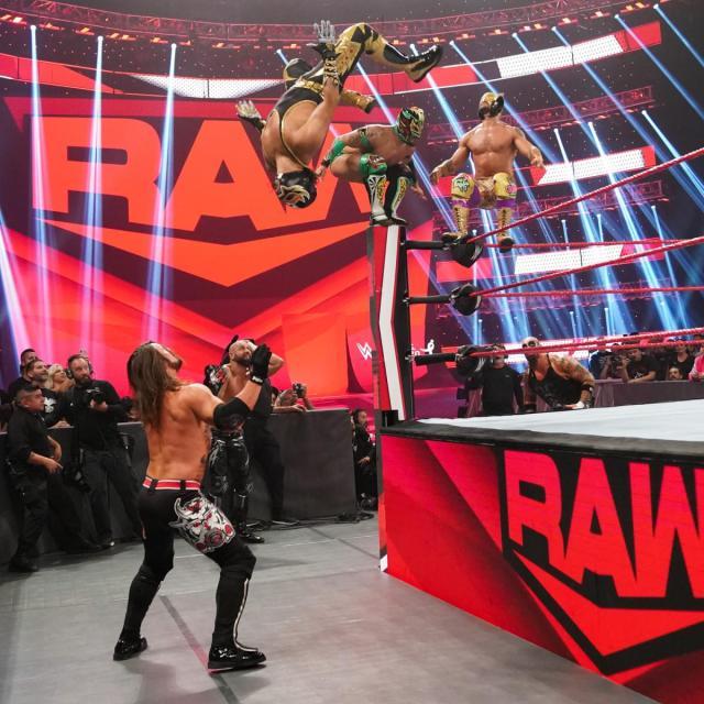 Lucha House Party hitting a triple moonsault onto The O.C. via WWE.com