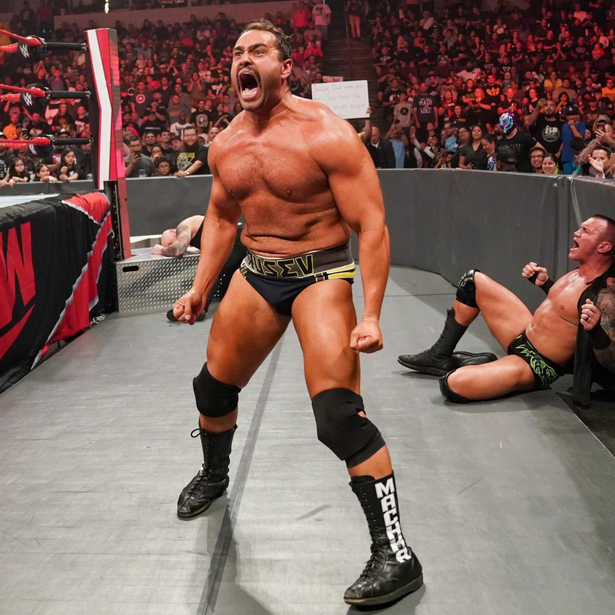 Rusev (foreground), King Corbin (background-left), Randy Orton (background-right) via WWE.com