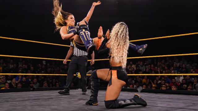 Tegan Nox blasting Taynara Conti with the Shiniest Wizard in her ring return via WWE.com