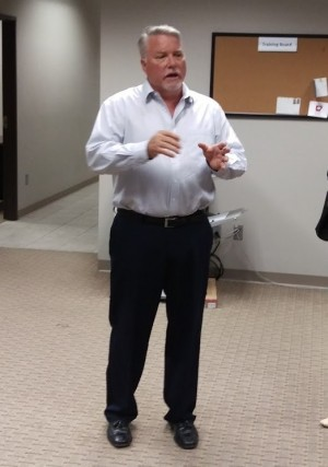 Kevin Clark, CEO of NowDX, speaks to a group touring the facility located in Springdale, Arkansas