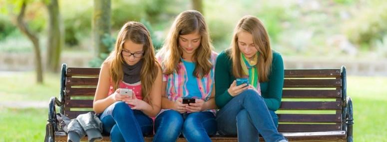 Teen girls using their mobile phones