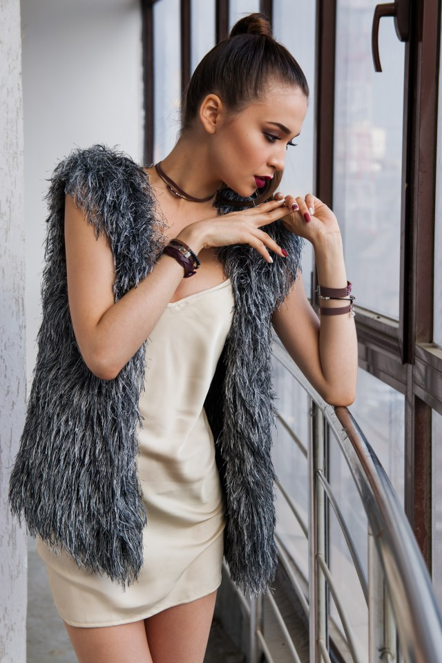 woman wearing choker and vest as example of cyclical nature of fashion