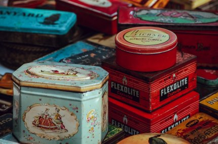 A pile of assorted tin containers