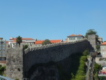 Medieval wall around the city that borrows from the Moorish style