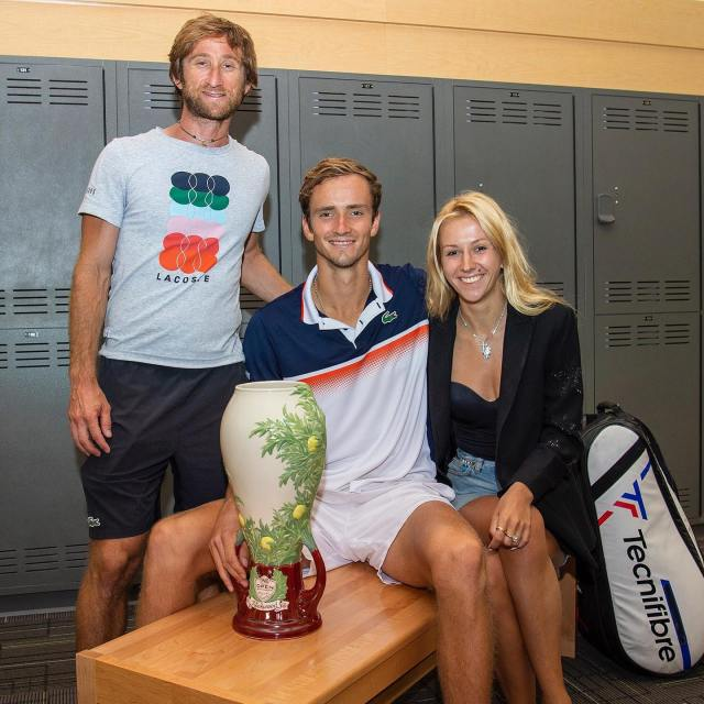 Daniiil with his team and wife Daria