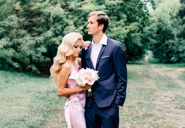 Daniel Medvedev in a suit with his wife Daria dressed in a beautiful dress