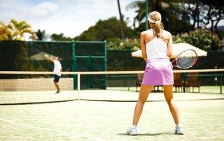 tennis-tourist-courtesy-four-seasons-maui-Woman-playing-tennis