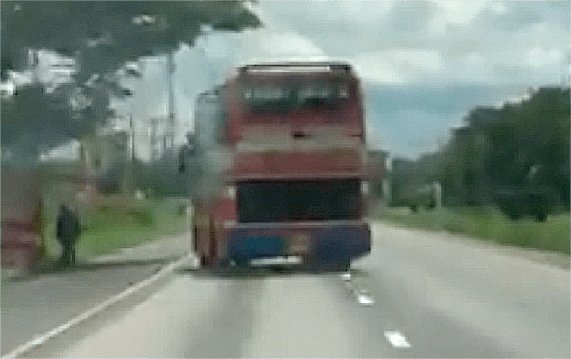 Thai Bus Travels 'Sideways' Along North-East Highway