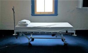 A hospital in the Northeast is suspending emergency treatment after a patient dies from Covid-19
