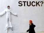 Stuck person on wall