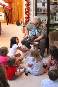 Braddon Mendelson reads to children at party celebrating release of his new book.