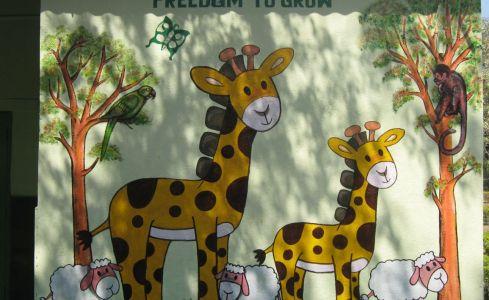 grafitti on a wall at a preschool