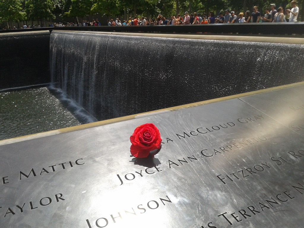 A single rose on one of the 9/11 memorials