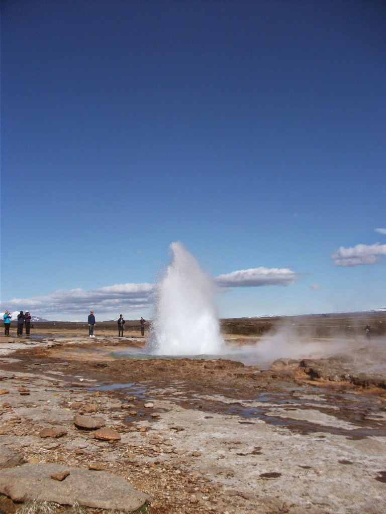 Stokkur geyser boiling over during the Golden Circle Tour