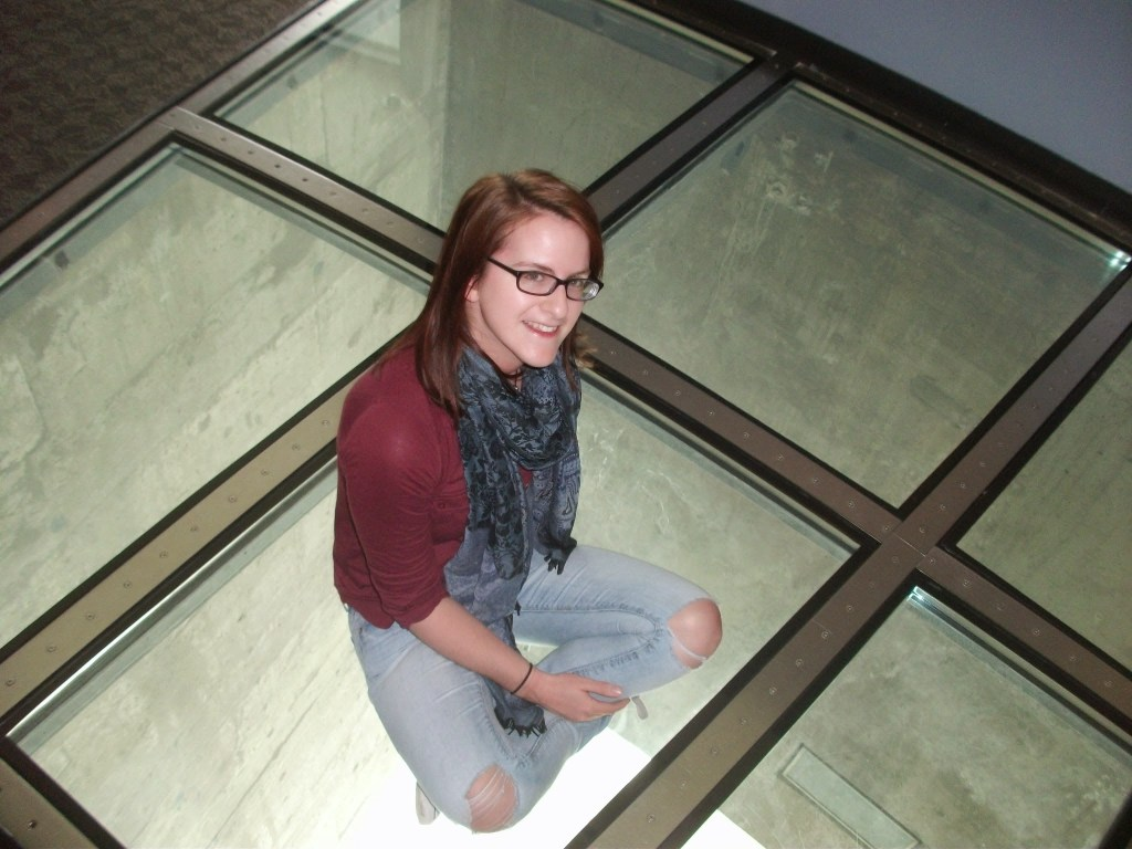 Sitting on the floor of the CN Tower