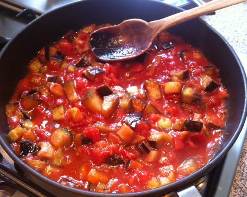 When Aubergines are cooked, add the chopped tomatoes