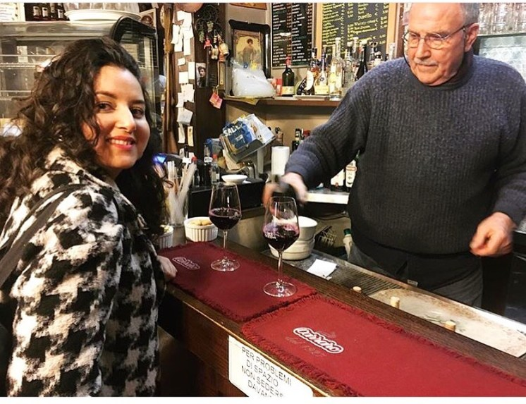 Getting served a glass of wine