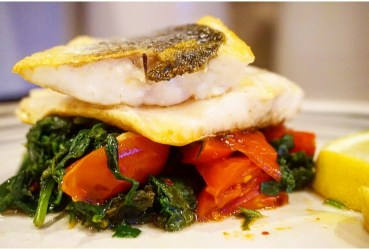 Pan fried Sea bass with spinach and tomatoes