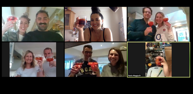 A group of people on a zoom call enjoying a Tiny Italian online cooking class experience