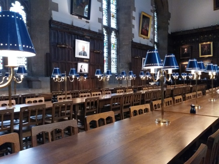 The dining hall in New College, Oxford, with long tables and vaulted ceilings
