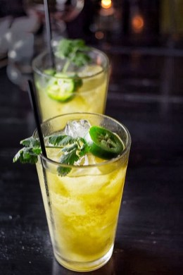Cadejo Blanco ~ Anejo oro Rum, Plantaton Pineapple Rum, Bitter Liquor, Mango, Chimmichuri Greens, Lime (photo by Chamere Orr)
