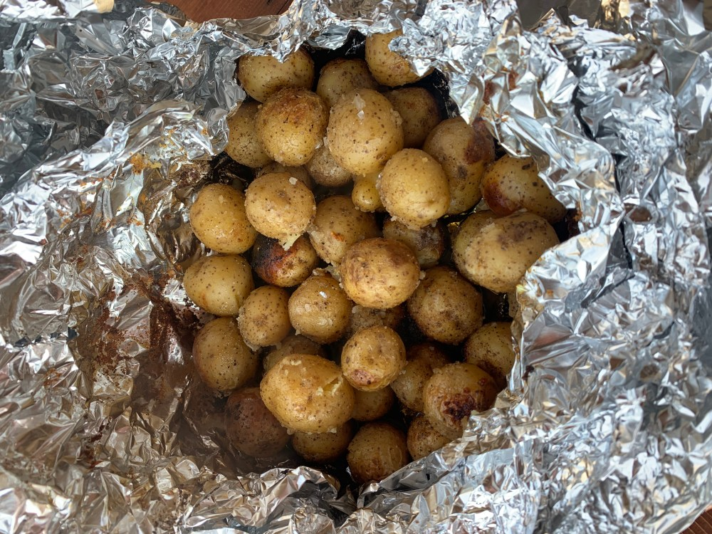 A bunch of baby potatoes in a tin fil bowl