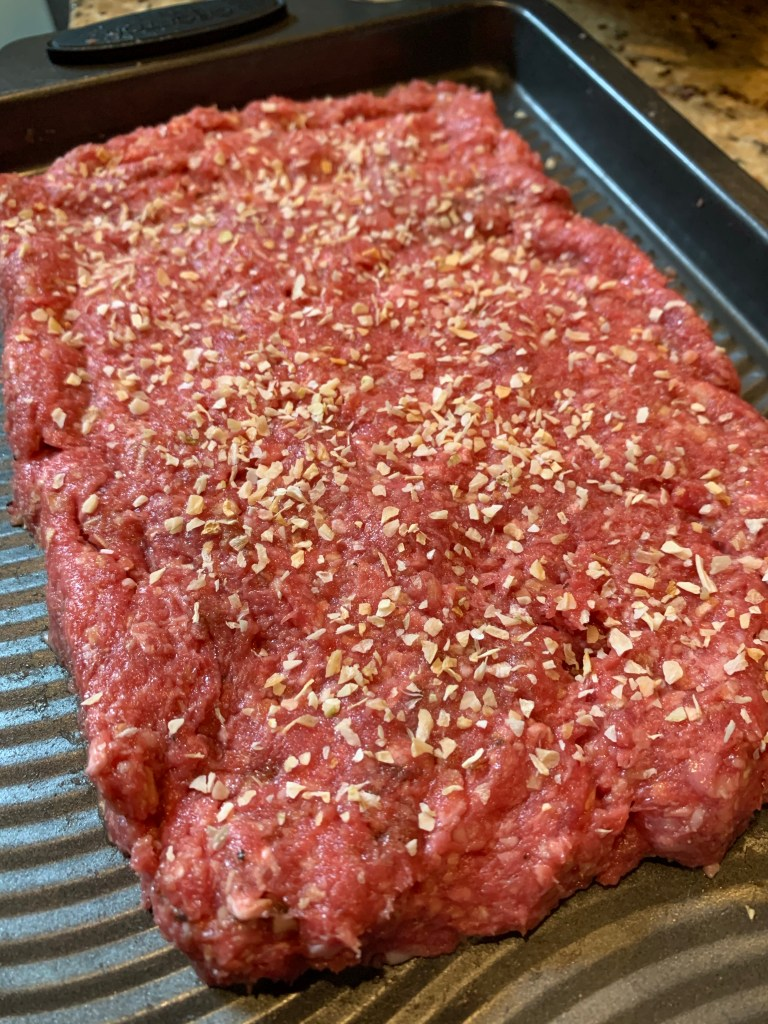 ground meat formed into a large beef patty