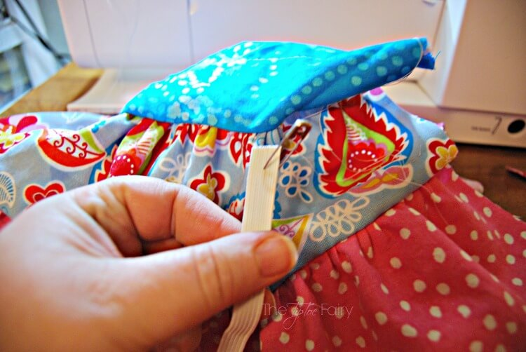 Use a safety pin to thread the doll twirly skirt
