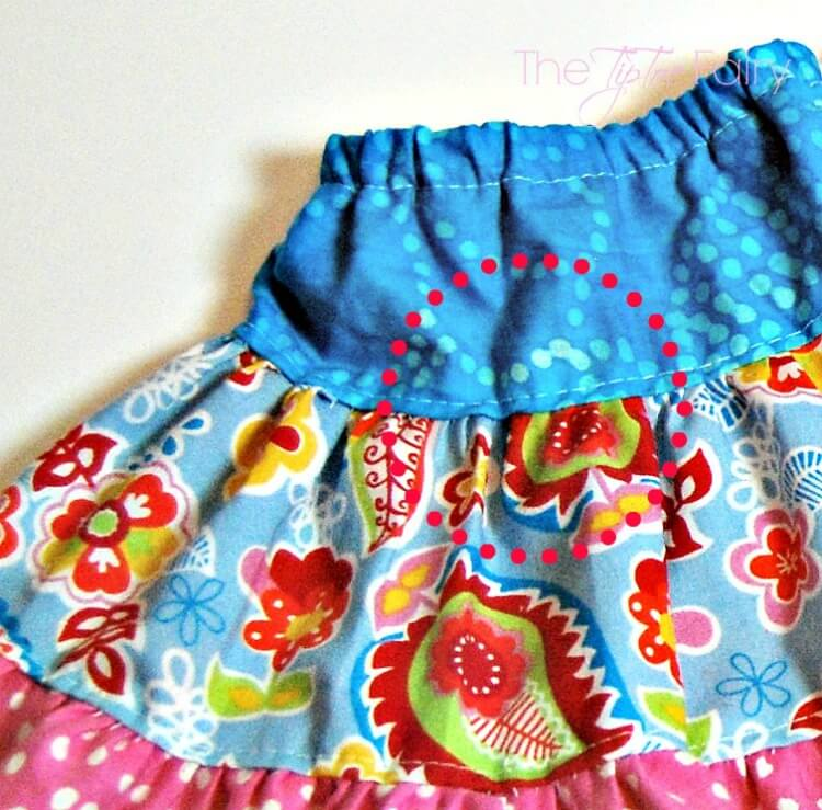 Topstitch the layers of the Doll Twirly Skirt