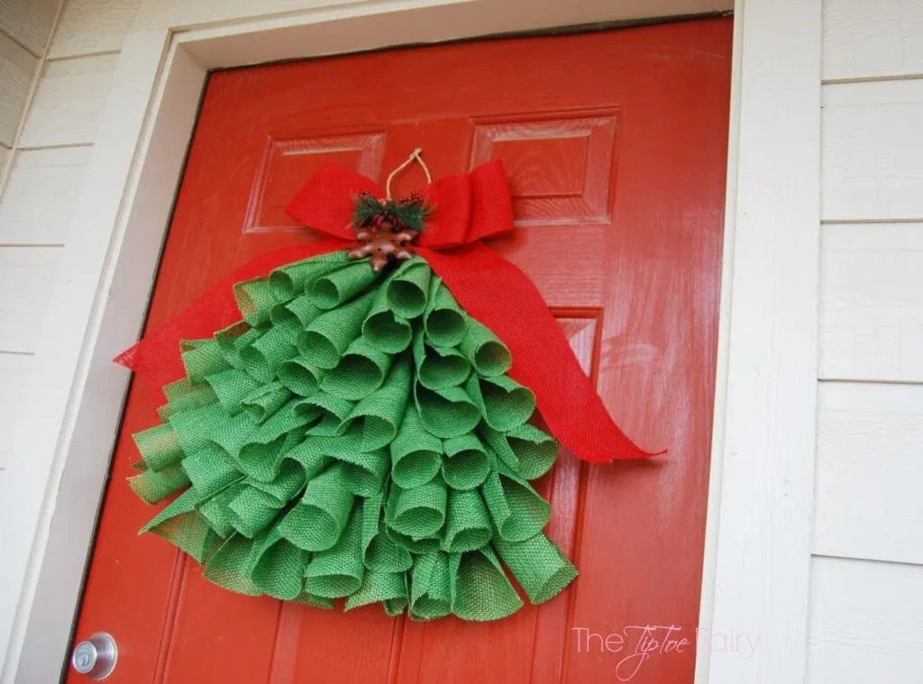 Another close up of the burlap christmas tree on the door.