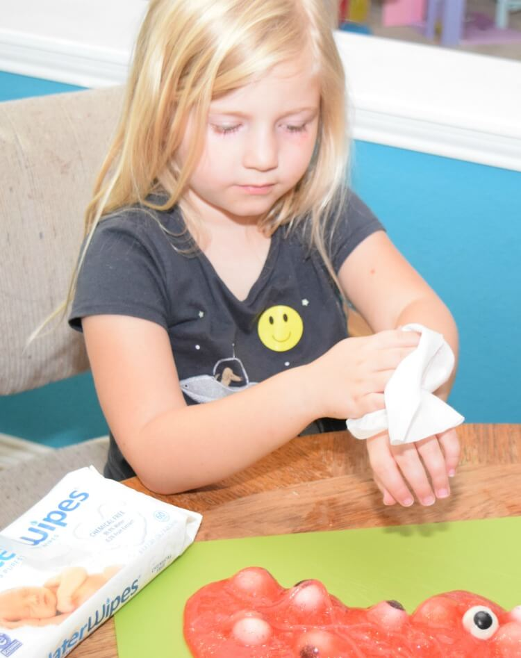 Easy clean up with WaterWipes after slime play.