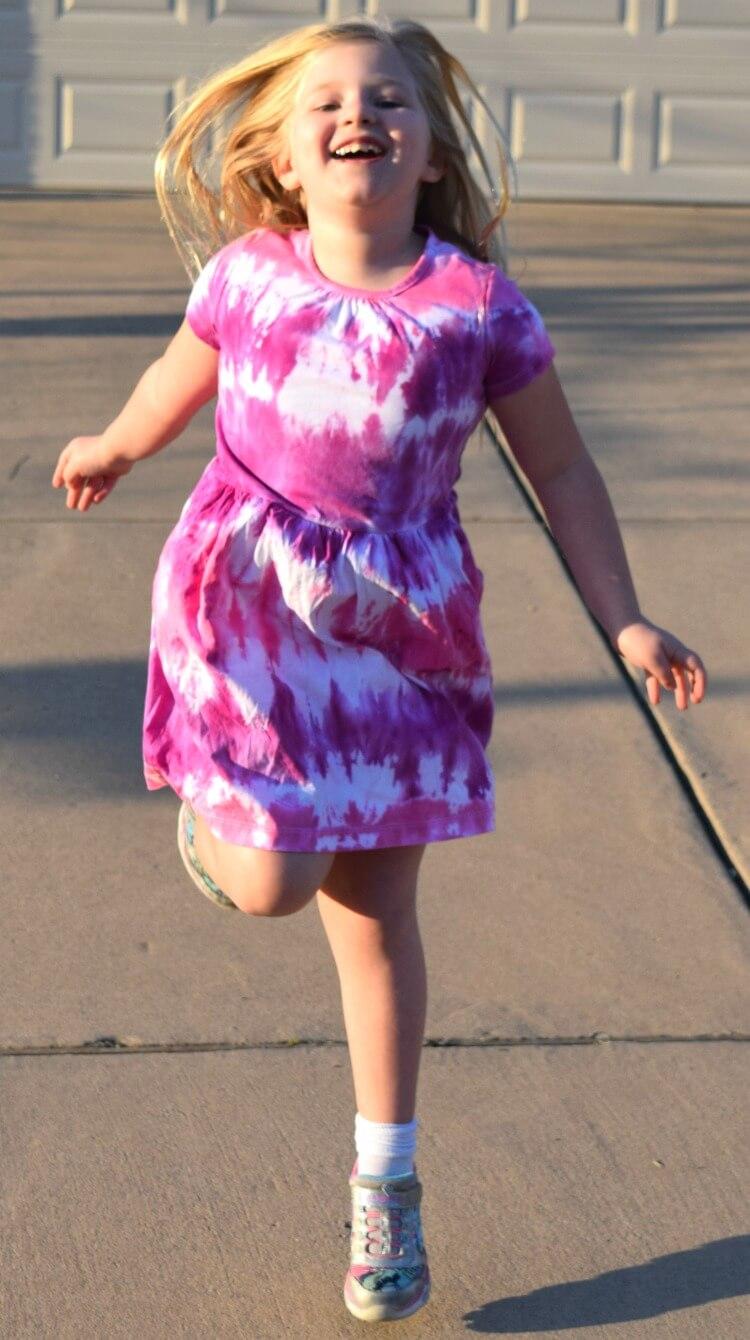 She loves her new tie dye dress!