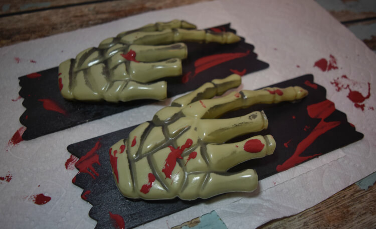 Blood spattered hand signs.
