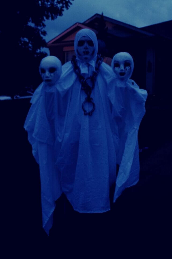 A very dark view of the three-headed ghost halloween costume
