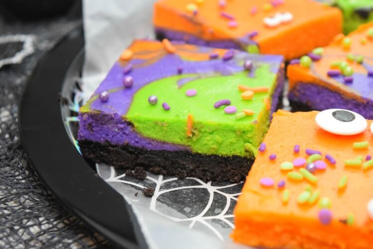Super close up of the layers of Monster Mash Halloween Cheesecake Bars