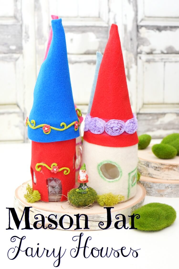 Mason Jar Fairy Houses on a wood slab