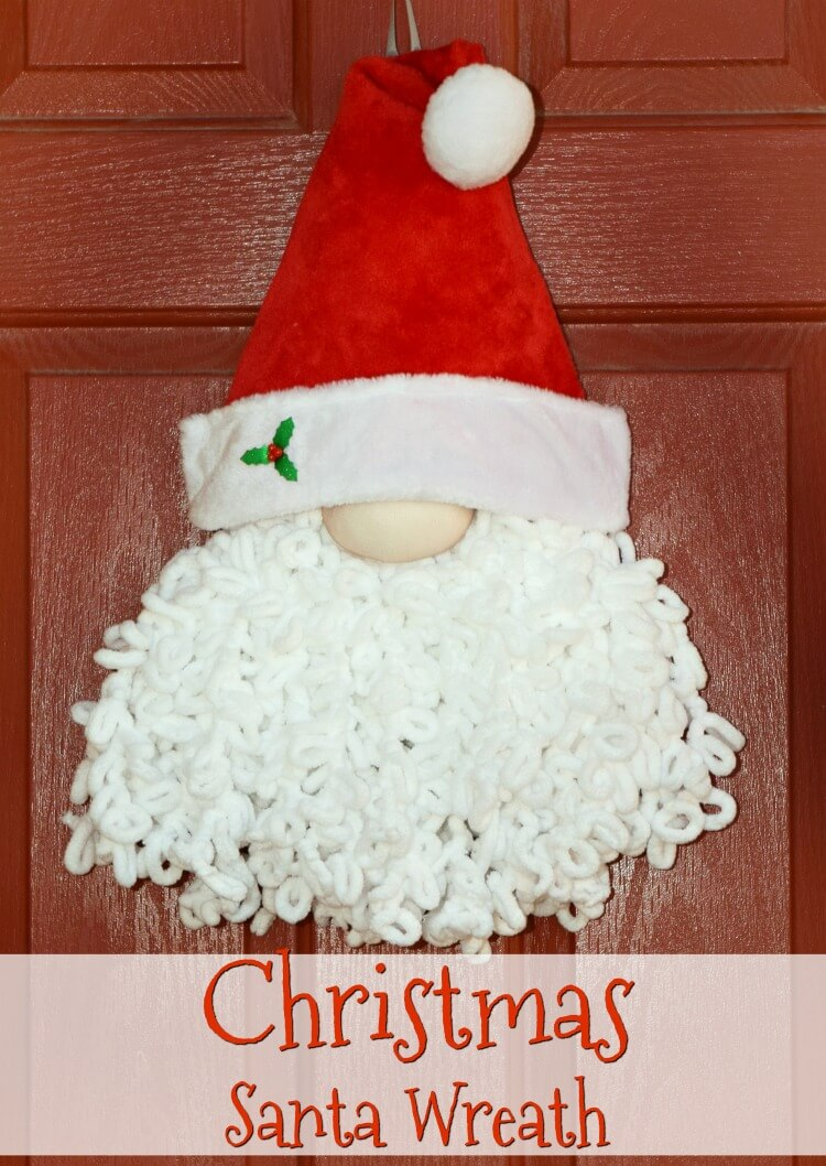 A Loopy Yarn Christmas Santa Wreath on a red front door
