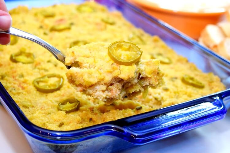 A spoonful of the jalapeno spicy cornbread dressing over the casserole dish.