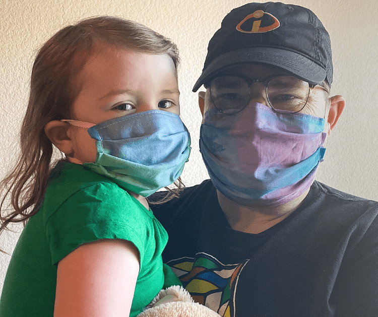 Daddy and toddler wearing elastic-back face masks