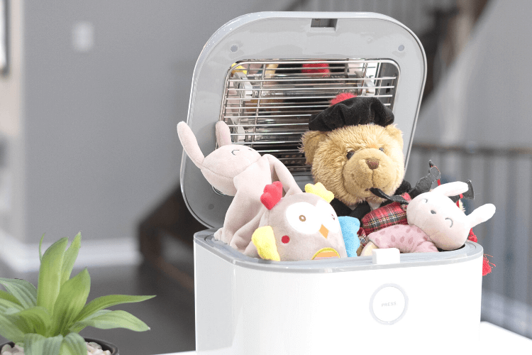 The sanitizer stuffed full of toys and stuffed animals for babies.