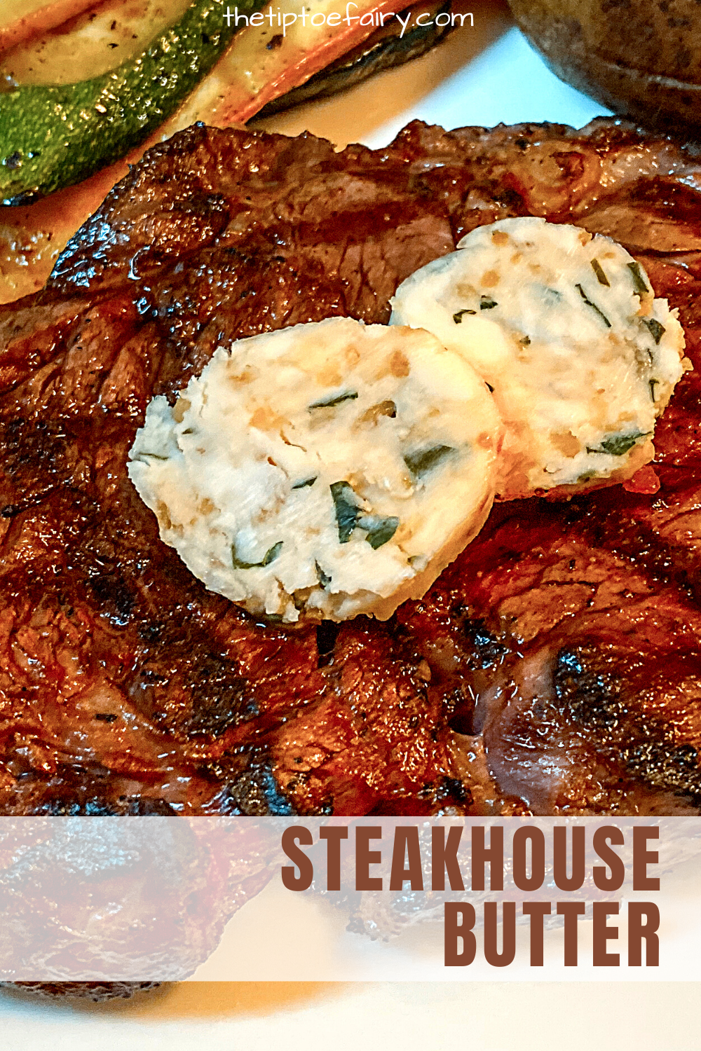 Close up view of a grilled ribeye steak with two slices of steakhouse butter on top of it.