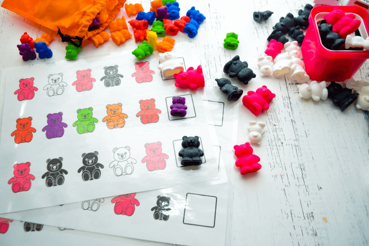 Plastic rainbow bears and eBook pages for making patterns.