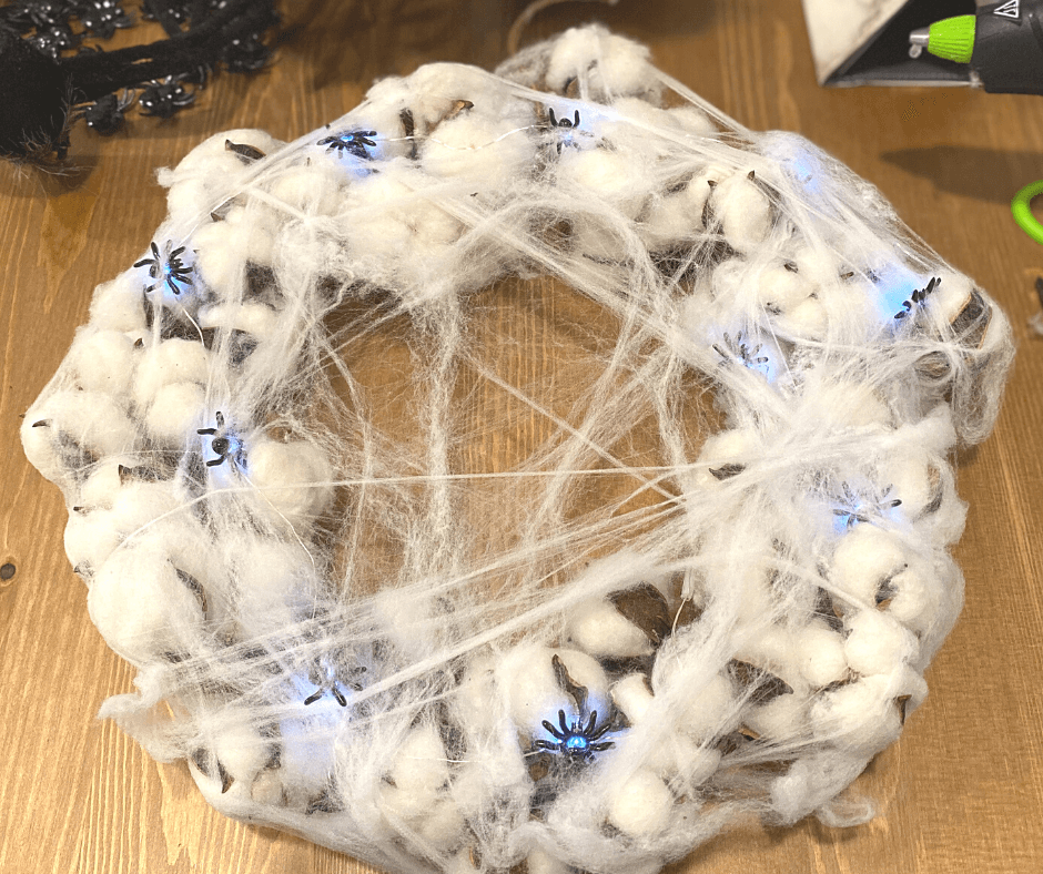 Stretch the spider web all over the wreath