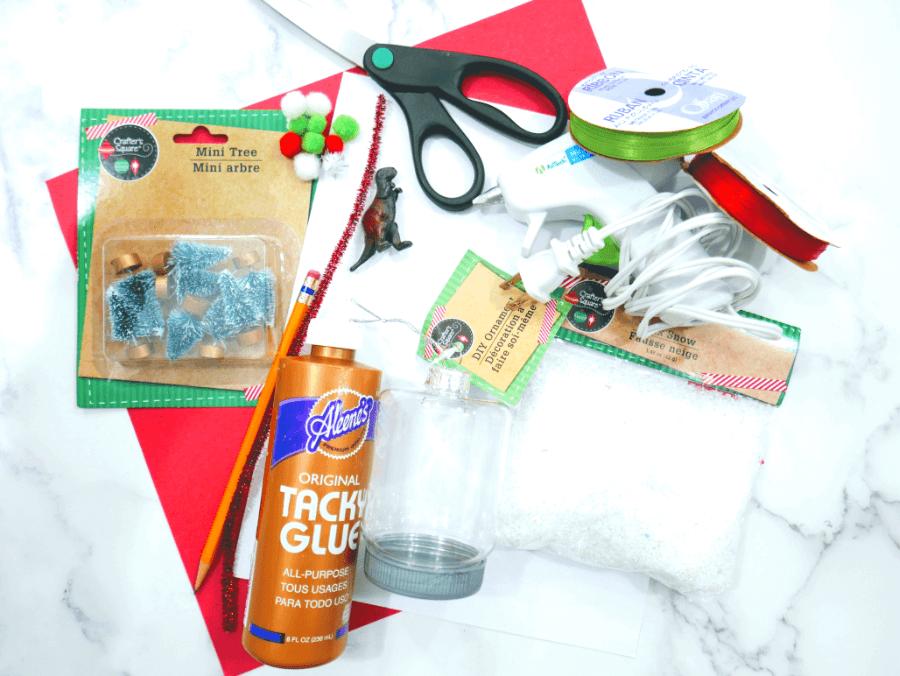 Supplies for the DIY Santa Dinosaur Christmas Ornament