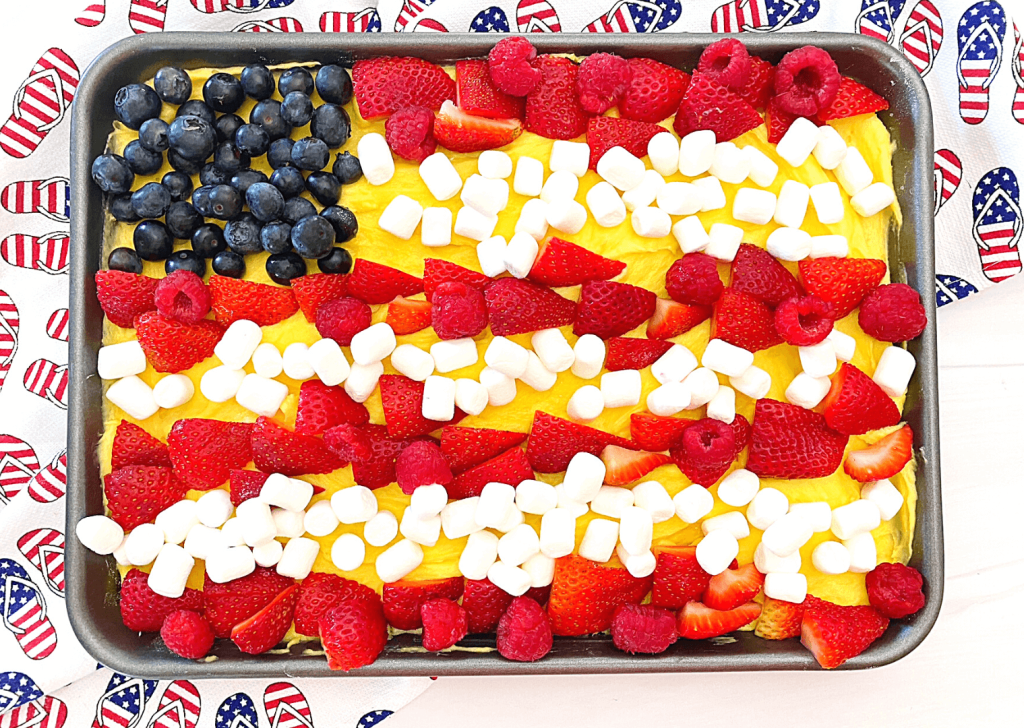 Finished 4th of July Fruit Pizza with strawberries, raspberries, and blueberries and mini marshmallows.