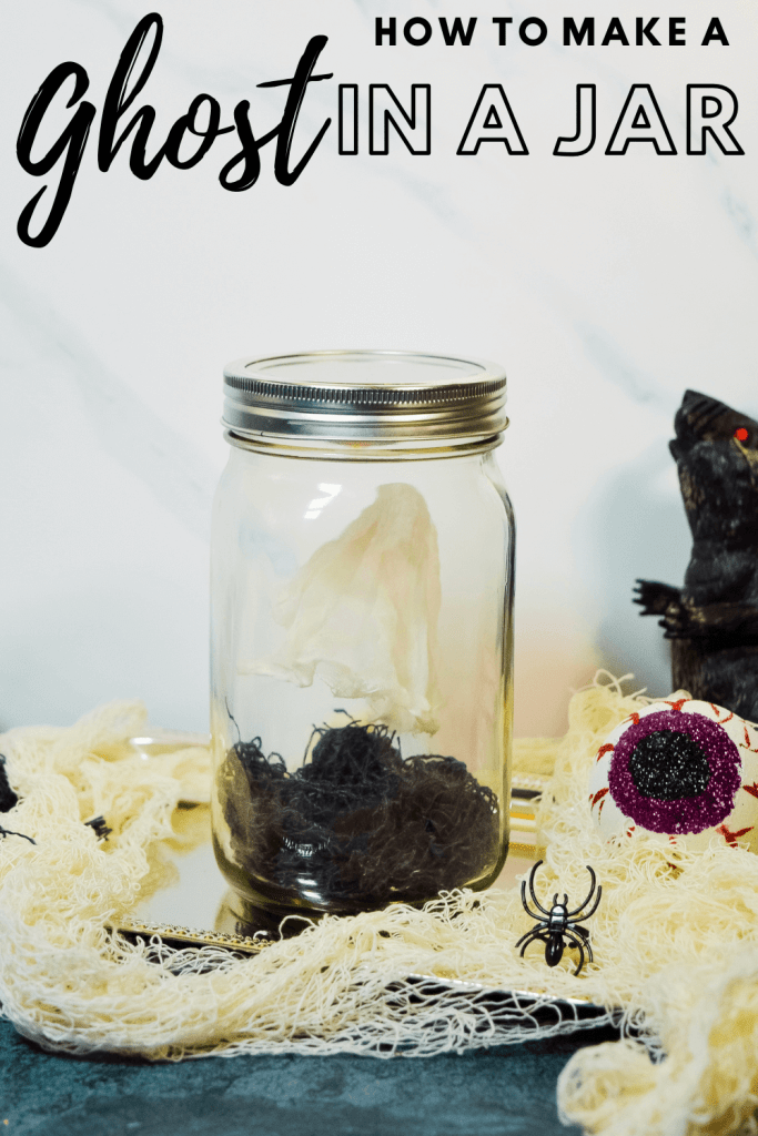 Ghost in a jar with a plastic rat next to it