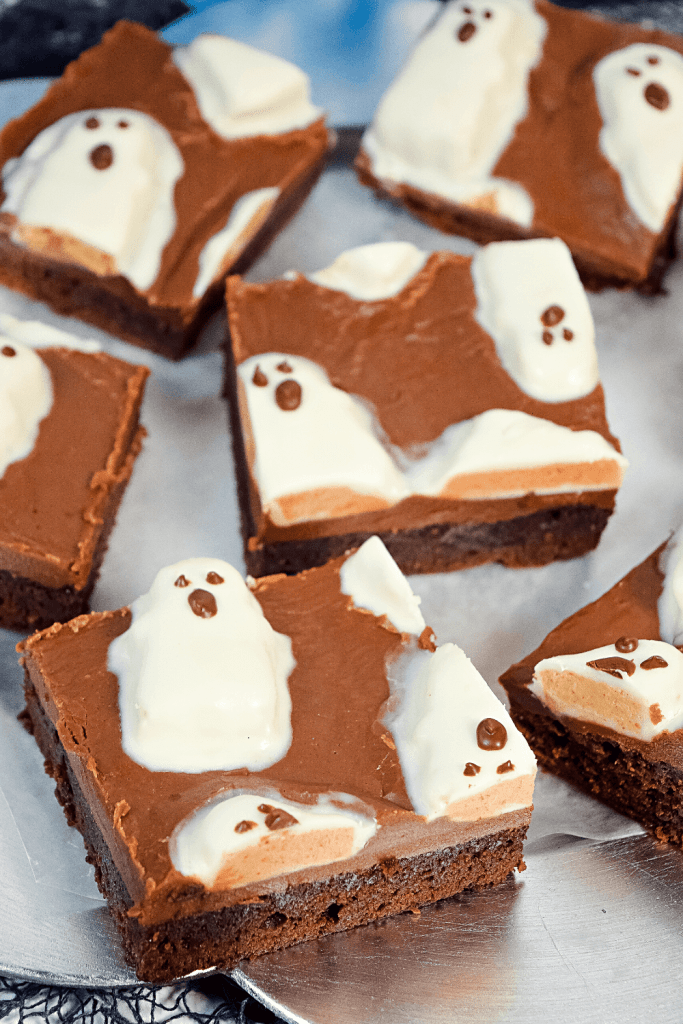 Close up image of cut up squares of the peanut butter ghost brownies