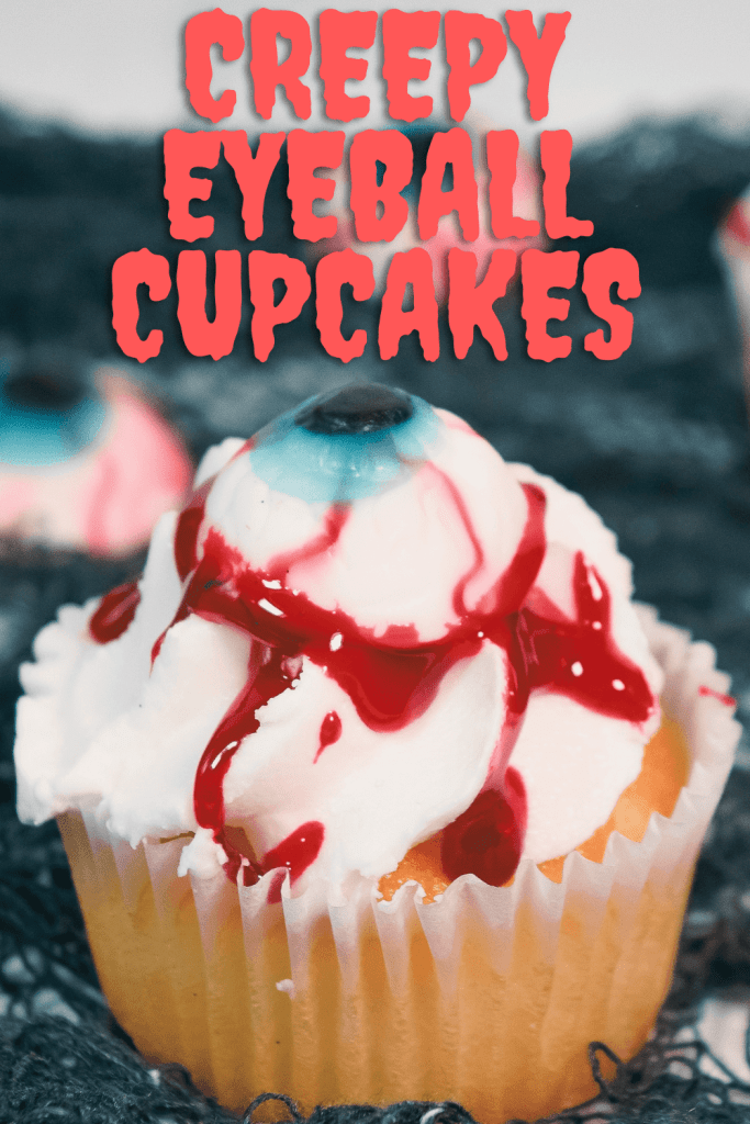 Creepy Eyeball Cupcakes made from store bought cupcakes with a gummy eyeball and blood glaze dripping down the white frosting